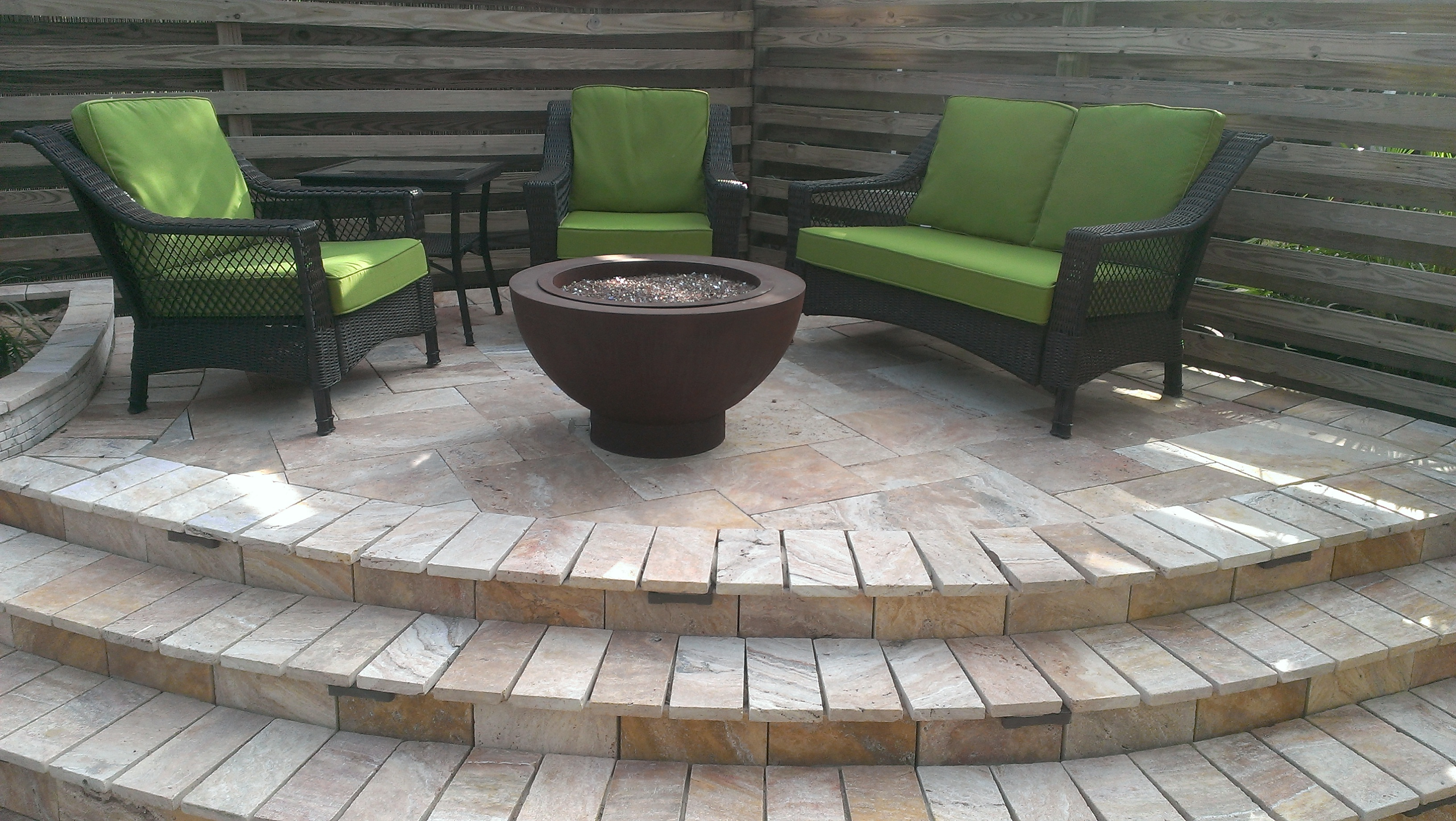 We can help you design a raised patio, just like this residential setup in Destin, FL